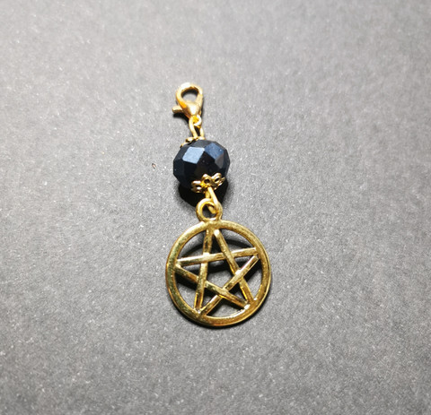 Pentagram place marker with a Black bead