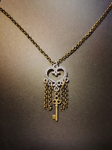 Heart necklace with chains and key