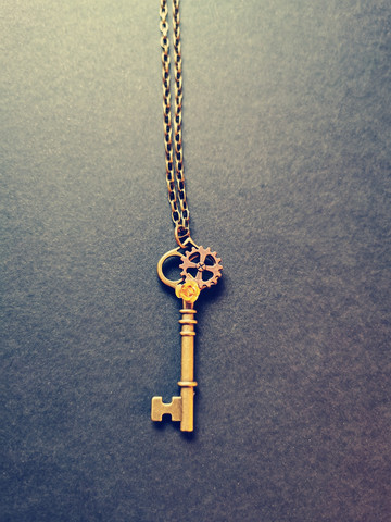 Key necklace with rose and gear