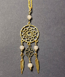 Gold colored dreamcatcher necklace