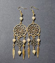 Gold colored dreamcatcher earrings with stones