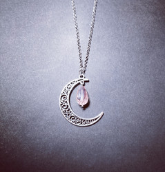 Crescent moon with pink droplet