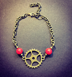Steampunk gears bracelet with red beads