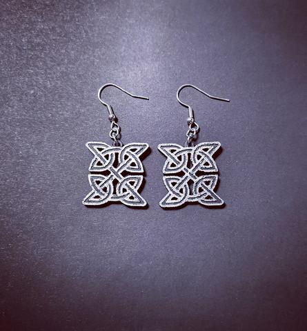Silver colored celt earrings
