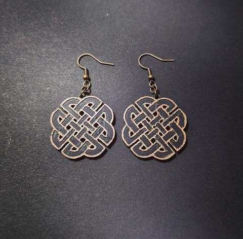Bronze colored celt symbol earrings