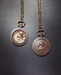Pocket watch necklace with skull and gear