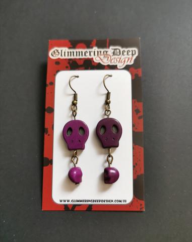 Violetin väriset pääkallo korvakorut