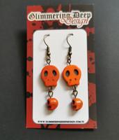 Orange golored skull earrings