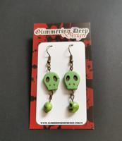 Green golored skull earrings