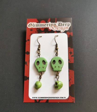 Green golored skull earrings