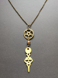 Gold colored clock pointer necklace