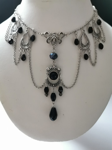 Silver colored goth necklace with black droplets and dome