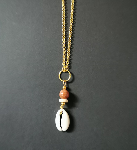 Clam necklace with a sandstone bead