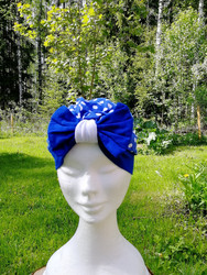 Blue bow hat with white dots and blue bow