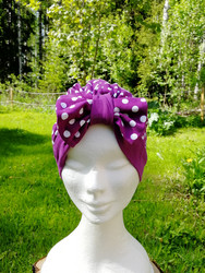 Violet bow hat with white dots