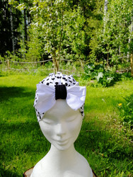 White bow hat with black dots