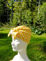 Yellow hat with bow and white dots
