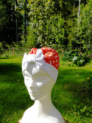 Orange hat with bow and white dots