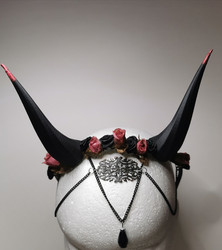 Black horns with pink flowers