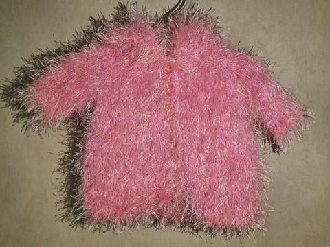 Nuken turkki hupulla vaaleanpunainen kimalteella