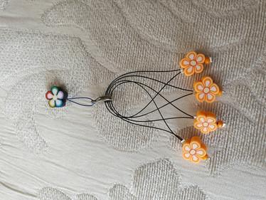 Silmukkamerkkisetti 4+1 :  oranssit kukat