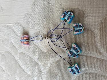 Silmukkamerkkisetti 4+1 :  siniset perhoset