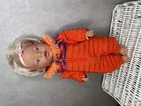 Nuken haalari, oranssin punainen