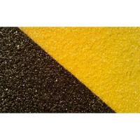 Keltainen / musta vinoraita liukuestoteippi kovalla pinnalla