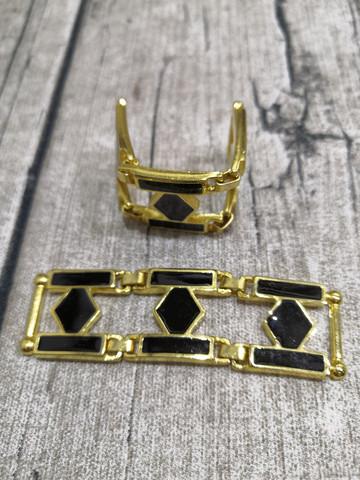 Musta/kulta nivelletty koriste