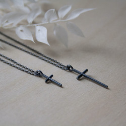 SIRO cross necklace in black by Sini Kolari