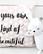 Pilkullinen tyyny tekstillä
