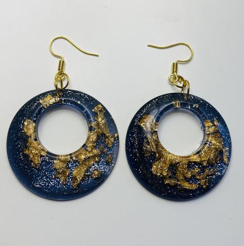 Kulta ympyrä, metallimusta