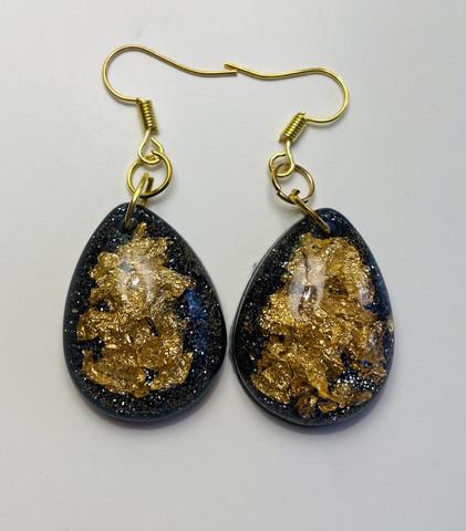 Kultapisara, metallimusta