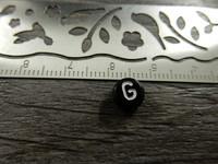 Kirjainhelmi G, 7mm, musta, 1kpl