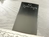 Korvakorukortti, 5x9cm, musta tekstillä, 1kpl