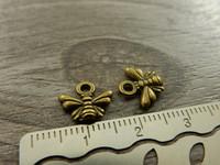 Ampiainenriipus, 10x11mm, pronssi, 1kpl