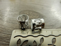 Metallihelmi/ hela, 9x8mm, kirkashopea 1kpl