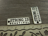 Strong is beautiful riipus, 27x10mm, kromi, 1kpl