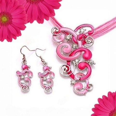 Pinkki Kiemurat korusetti kristalleilla