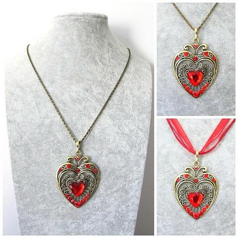 Iso kaunis pronssinvärinen sydänkaulakoru punaisilla tekojalokivillä