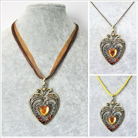 Iso kaunis pronssinvärinen sydänkaulakoru keltaruskeilla tekojalokivillä