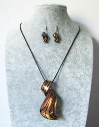Ihana loivakierteinen rusehtava-musta-kultainen lasikorusetti