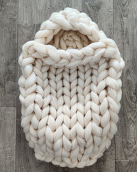 Chunky knit babynest and a blanket