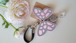 Reflector black/rose butterfly