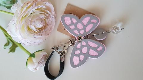 Reflector black/rose butterfly