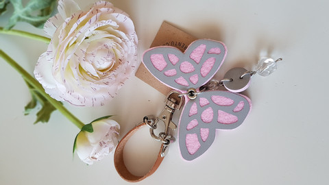 Reflector brown/rose butterfly