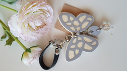 Reflector white/black butterfly