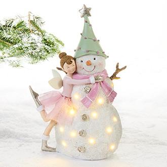 Keiju ja lumiukko valoilla