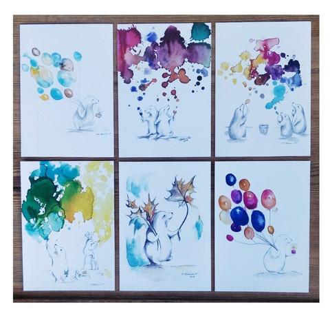 Kuusi erilaista iloista postikorttia