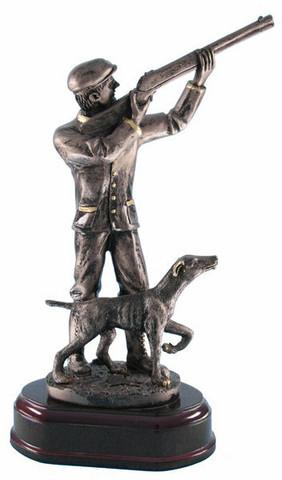 Metsästäjä ja koira -patsas